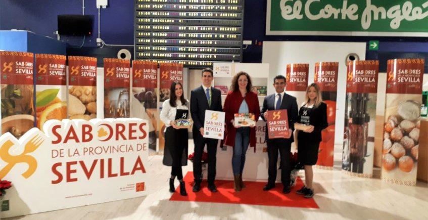 Los 'Sabores de la Provincia de Sevilla' reciben en el aeropuerto a los visitantes que regresan a la ciudad por Navidad
